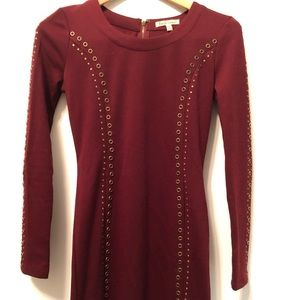 Maroon dress with brass embellishments